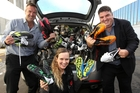 GOOD HAUL: Sport Hawke's Bay's former commercial manager Kevin Murphy (left), development officer primary schools Sally McKenzie, and Hawke's Bay Today editor Andrew Austin, with last year's donated boots. PHOTO/FILE