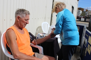Carterton truck driver Lance Riddell has his blood pressure checked by nurse Liz Harvey at a truck stop.
