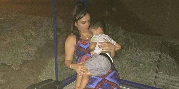 Aileen Chand with her young boy at a bus stop after she was refused on board a Tiger Airways flight. Photo / Facebook