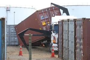 TRAGEDY: The scene where a man was crushed between a shipping container and a truck yesterday on Totara St, Mount Maunganui.PHOTO/JOHN BORREN