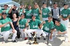 Saints premier men's softballers celebrate their third post-Christmas title on the trot. Photo / Duncan Brown
