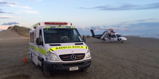 RESPONSE: The Northland Rescue Helicopter on Ninety Mile Beach after a fisherman's four-wheel-drive rolled, leaving him with serious injuries. PHOTO/NORTHLAND RESCUE HELICOPTER