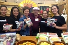 Students from Ruawai College and members of Keeping it K with the owners of Proper Crisps at the Auckland Food Show.