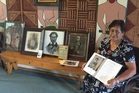 Tanira Te Au sits in the wharenui of Houngarea Marae with photographs of her ancestors which have been restored specially for the centennial on Wednesday. Photo / Kaysha Brownlie