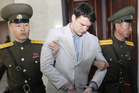 American student Otto Warmbier is taken away from the Supreme Court in Pyongyang. Photo / AP