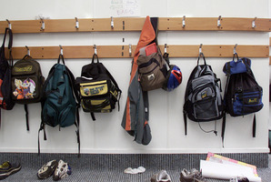School bags and kids shoes line the corridor at a small country school. Photo / Greg Bowker