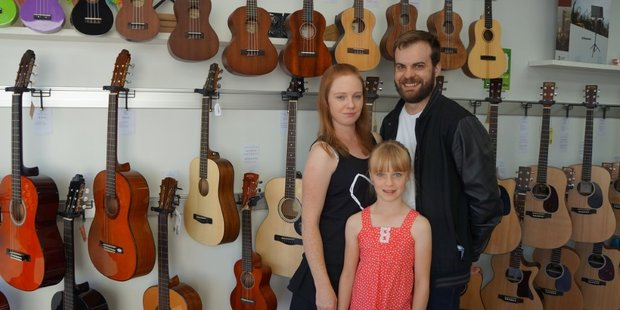 Love Music owners Emily and David Love, with their daughter Abbie.