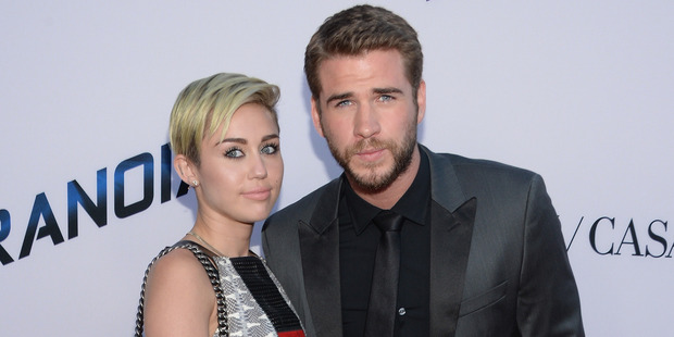 Miley Cyrus and Liam Hemsworth pictured together in 2013. Photo / Getty Images