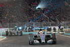 Lewis Hamilton steers his racer in front of his Mercedes teammate Nico Rosberg. Photo Getty Images