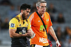 Nehe Milner-Skudder leaves the field after injuring his shoulder against the Blues. Photo / Getty