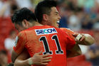 Sunwolves players celebrate a try against the Cheetahs. Photo / Getty