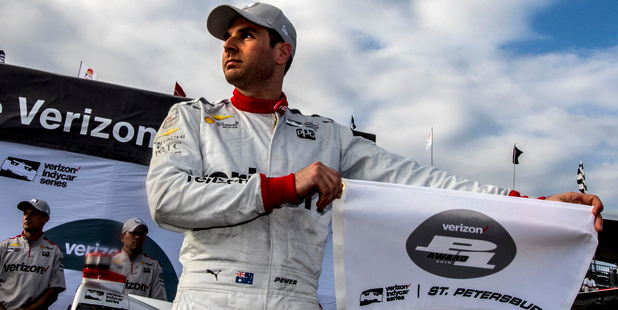 Will Power holds the P1 flag after winning the pole position for the Firestone Grand Prix. Photo / Getty Images