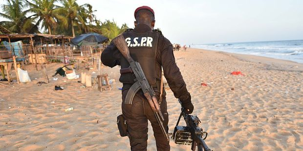 Ivory Coast's soldier carries a machine gun as he walks on the beach resort of Grand-Bassam. Photo / Getty