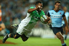 Ryan Tongia dives over to score against the Waratahs. Photo / Getty