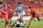 Male Sa'u of the Blues breaks through the Reds' defence. Photo / Getty