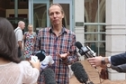 "Nicky Hager has emerged from the High Court at Auckland clutching smashed clones of his hard drive and memory card seized during an ""unlawful"" search."
