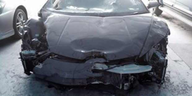 The front end of the Lamborghini Huracan is crumpled from the crash.  Photo / Trade Me