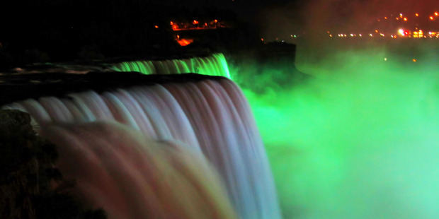 The Niagara Falls are illuminated green for St Patrick's Day. Photo / Supplied