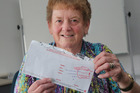 Olga McKerras with the letter that took 15 months to reach her.