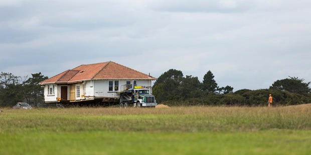 The Hobsonville Point house on the move. Photo / Supplied