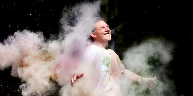 Graeme Dingle Foundation Bay of Plenty regional manager Dan Allen-Gordon gets a blast of colourful dust at the teaser event for Colour Dash.