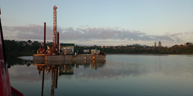 A drill rig was used to bore deep into the sediment of Auckland's Orakei Basin to retrieve ancient evidence of volcanic eruptions. Photo / Supplied