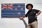 Tony Waring with his sculpture of the New Zealand flag at Motu Moana Scout Camp. Photo / Nick Reed