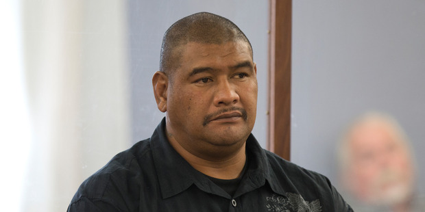 Former prison officer Alofainu'u Tuisamoa in the dock during his sentencing. Photo / Mark Mitchell