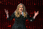 Adele is said to be fuming after hacked personal photos were posted online.