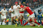 England's Anthony Watson, left, tries to get past Wales' Alex Cuthbert during the Six Nations international rugby match between England and Wales. Photo / AP