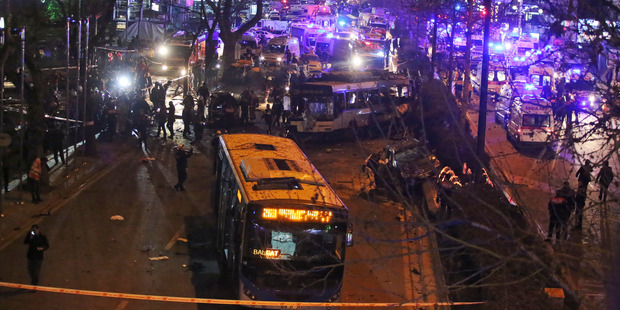The explosion occurred as a car slammed into a bus. Photo / AP