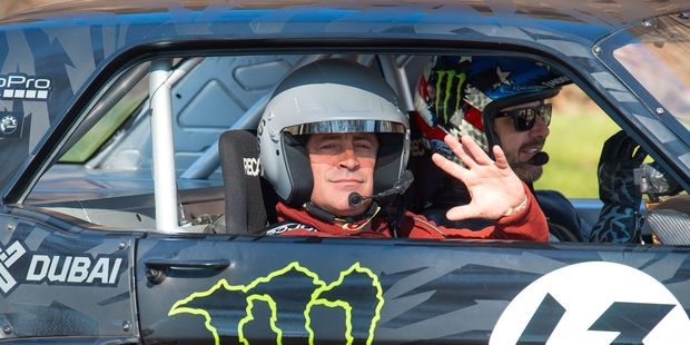 Actor and Top Gear presenter Matt LeBlanc waves as he sits with rally driver Ken Block during the filming of BBC Top Gear in Westminster, London. Photo / AP