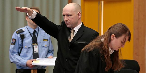 Anders Behring Breivik gestures as he enters a courtroom in Skien, Norway. Photo / AP