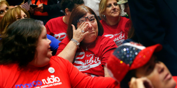 A supporter of Republican presidential candidate Marco Rubio wipes a tear during a Republican primary night celebration rally at Florida International University. Photo / AP