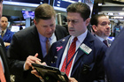Traders Edward Schreier, left, and Anthony Carannante confer on the floor of the New York Stock Exchange. Photo / AP