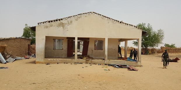 People inspect a damaged mosque following a suicide bomb explosion in Maiduguri, Nigeria. Photo / AP