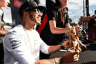 Lewis Hamilton answers questions, but none about his Harley-Davidson ride, before this weekend's Australian Grand Prix.  Photo / AP