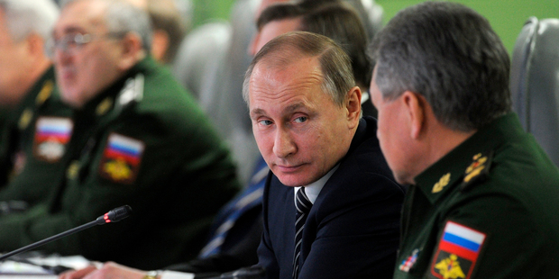 Vladimir Putin says the task presented to Sergei Shoigu (right) has been completely fulfilled. Photo / AP