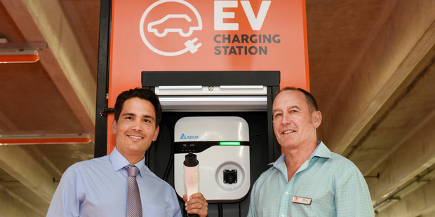 Transport and Energy minister Simon Bridges (left) and Bayfair Centre manager Steve Ellingford with the new electric vehicle charging station in Tauranga. Photo / George Novak