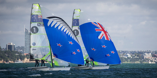 New Zealand 49er sailors Peter Burling and Blair Tuke show off the flag options. Photo / Greg Bowker