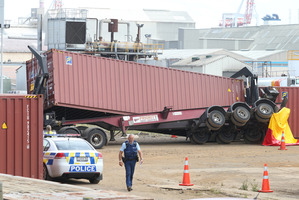 The scene where a man was crushed between a shipping container and a truck on Totara St, Mount Maunganui. Photo/John Borren