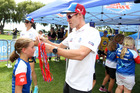 Ironman legend Cameron Brown presents winners' ribbons at a Sanitarium Weet-Bix Tryathlon - one of the company's health promotion activities. Photo / Duncan Brown.