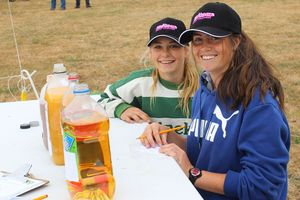 Calculating the sugar in drinks during the TeenAg event were Brenna Tait (left) and Phoebe Williams, of Iona College.