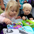 Daphne Price, 3, and Leo Price, 2, explore their artistic side at the craft stall.