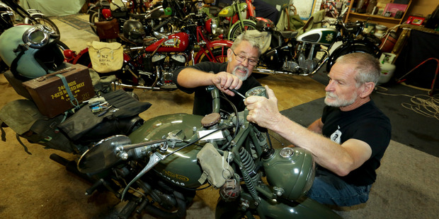 Jim Thorne (L) and  Jim Lord prepare one of the classic motorcycles in Clive for the 27th annual mail run ride from Taupo to Napier. PHOTO/WARREN BUCKLAND