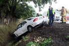 Aftermath of a car verses drainage ditch on  Tukituki Road Haumoana.