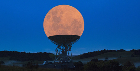 Kerikeri man Chris Pegman's composite image of a supermoon resting in a radio telescope is still getting attention, most recently on myth-busting website Snopes.com. PHOTO / CHRIS PEGMAN