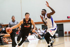 Hawks guard Luke Aston zips past Saints US import Torrey Craig in the Hawks' opening NBL basketball match in Napier.