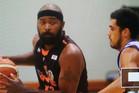 Hawks US import Kareem Johnson (left) takes stock as Saints guard Shea Ili breathes down his neck in Napier. PHOTO/Paul Taylor
