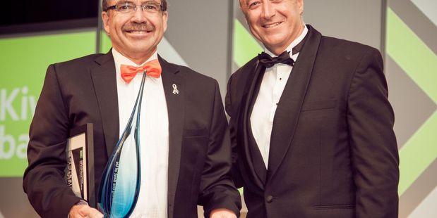 Local Hero award Selwyn Cook standing with Kiwibank CEO Paul Brock.